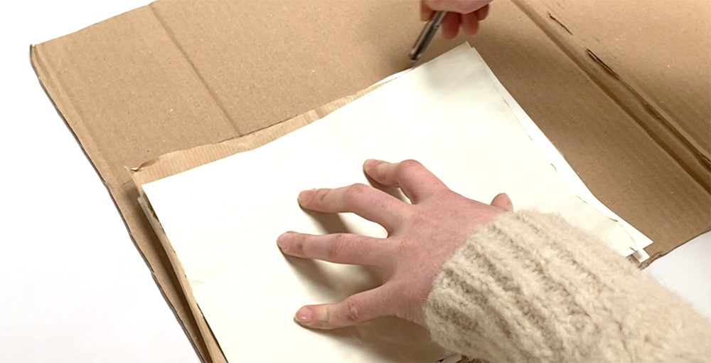 Making the cover of an elastic band sketchbook