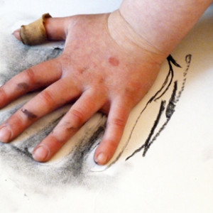 "Create a charcoal ""palette"" and use hands to explore the way primitive man might have made his mark."