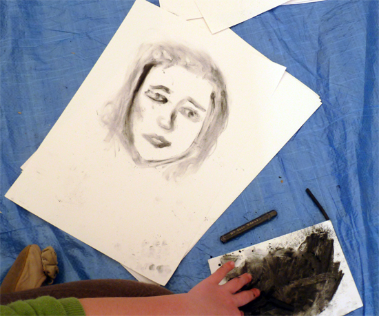 Fingers are used as a drawing tool to explore mark making and tonal values in charcoal.  This is a useful introduction to making self-portraits and encourages children to overcome preconceived ideas/expectations about what portraits should look like.