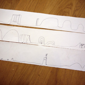 Talking children through a drawing to help trigger their imagination.