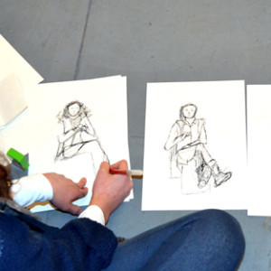 A relaxed session to introduce students to the first steps of drawing from life in a series of short exercises or 'studies'.    Teenagers work in pairs, drawing each other and to take away any inhibitions, a random selection of props is introduced: a mobile phone, I-touch, a book and a box of raisins to nibble on!