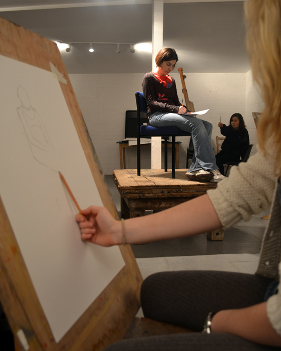 A workshop that explains the 'Sighting Method' to enable students to draw in proportion from a live model.  Teenagers are shown how to use their pencils to measure and plot the figure onto the paper in proportion, and to use verticals and horizontals to estimate the angles of the figure's pose.