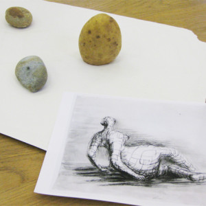 A fun session using the drawings of the sculptor Henry Moore to explore drawings with mass and volume.  Potates and pebbles are drawn using wax resist, ink and graphite to capture the weight of the objects.The second challenge is to make tiny playmobil figures monumental through drawing.