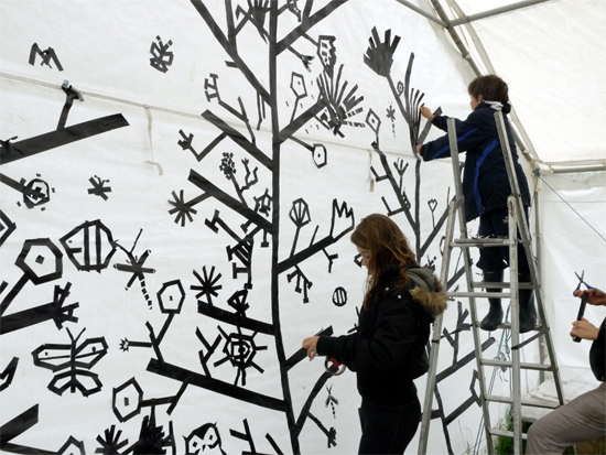 Artist Rebecca Hoyes transforms a marquee wall into a tree of life with gaffe and electrical tape.