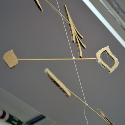 Using corrugated cardboard and dowell to create mobiles which balance and move.