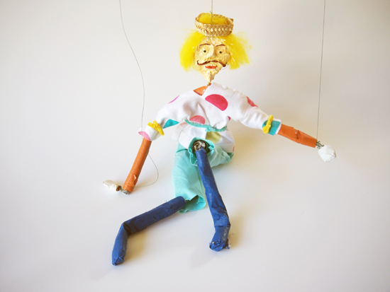 Characterful marionettes made from string, wire, newspaper and fabric.
