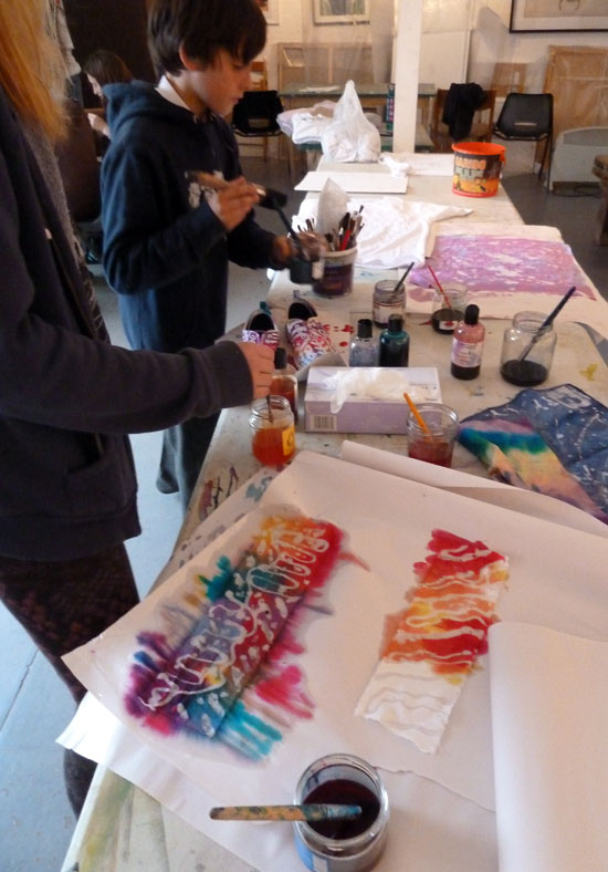 In this workshop teenagers work on various surfaces and explore a process which involves melted wax as a drawing tool and dye to add colour and reveal the design. The staged process is perfect for enabling young people to explore mark making, colour and design.