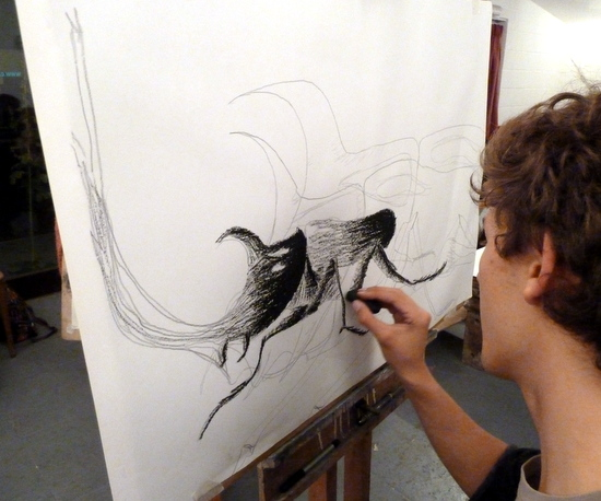 Drawing insects big: Adam drawing  a Rhinoserous Beetle on loan from Cambridge University Museum Of Zoology