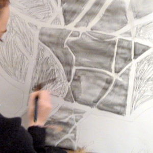 Learning to draw the spaces in between things, the 'negative space', lets drawings breath and tensions between objects resonate.  In this drawing activity, graphite washes are used to emphasise negative spaces.