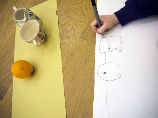 In the first of a three part workshop on painting a still life, children gain familiarity with the objects by making continuous line drawings. As well as tuning into the subject matter, the drawing exercises also encourage the children to consider the shape and dimensions of the canvases right from the start.