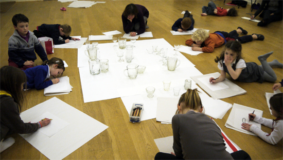 This resource encourages children to tackle foreshortening and aerial perspective by drawing from a still life of translucent glass.  The drawings are made on tracing paper and overlaid to explore small compositions before the class brings all their drawings together to make a large, communal still life.