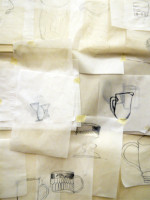 All the drawings taped to the wall to make one large still life