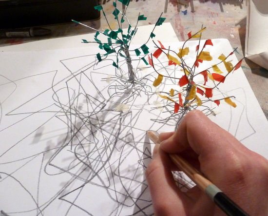 Drawing feeding making - tree growing from the paper