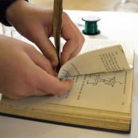 Not easy making holes in Leonardo's Notebook!