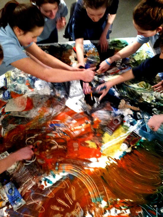 Group painting activity: girls battle it out with paint