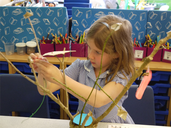 """Sticks secured in pots and then """"dressed"""" with inventive treehouse elements"""