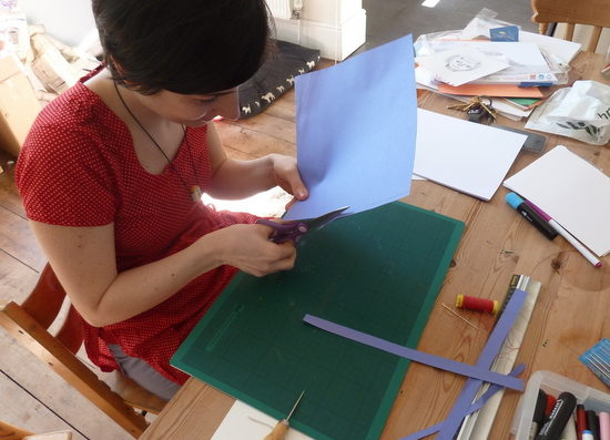 Artist Aurora Cacciapuoti demonstrates, step by step, how to bind a sketchbook