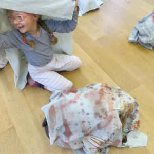 Children create large scale painted textiles inspired by rocks and fossils, and then use the textiles to turn themselves into rocks!
