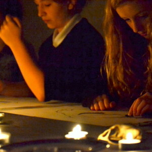 Students draw skulls, on loan from University of Cambridge Museum of Zoology, Cambridge, in candle light