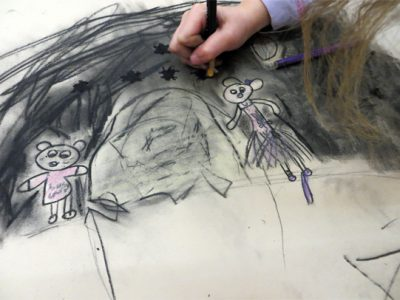Drawings which tell stories: young children use toys, poetry and their own text to create richly illustrated narratives.