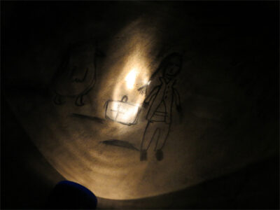 Drawing in charcoal by torchlight