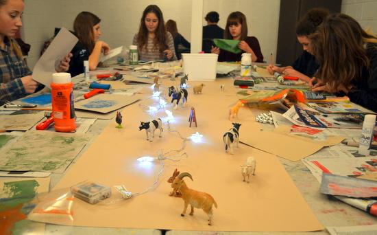 Teenagers draw toy farmyard and woodland animals