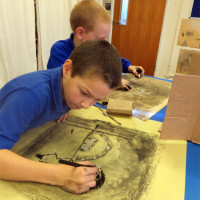 "Creating ""dramatic"" charcoal drawings"