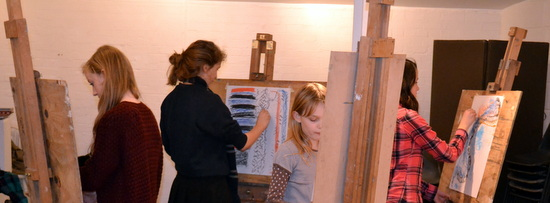 Teenagers draw in a group to 'The Magic Box'