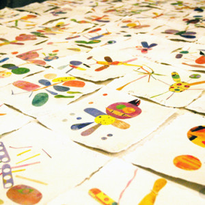 Artist Tracy McGuinness-Kelly leads pupils to create a  beautiful collaborative piece of work, inspired by minibeasts, for permanent display inside their school.