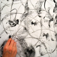 Kitty works in charcoal with invented forms and spontaneous mark making