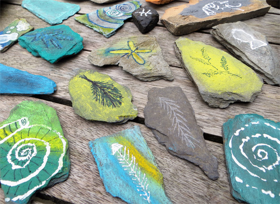 Drawing on pebbles with a variety of different drawing materials to create treasured and exotic fossils.