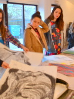 Students at AccessArt's Experimental Drawing Class look through their work