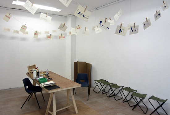 Experimental Drawing: Space set out for workshop - basic materials, suspended words on 'washing lines'