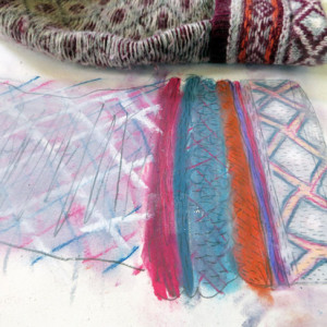 Working intuitively to capture the texture of folded clothing using soft pastel and graphite.
