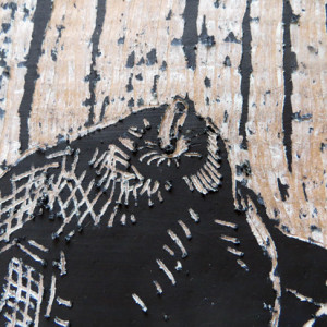 Acrylic painted over oil pastel on cardboard to create woodcut lookalikes. Teaches children to think about light/dark, positive/negative.