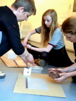Rachel Wooller demonstrates to teenagers