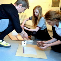 Rachel Wooller demonstrates to teenagers