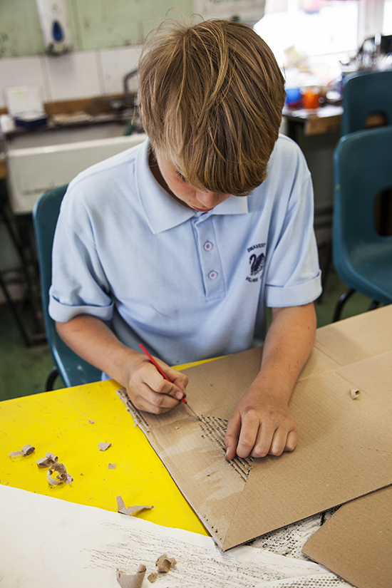 Student works transforming cardboard surfaces inspired by the surfaces of the school playground