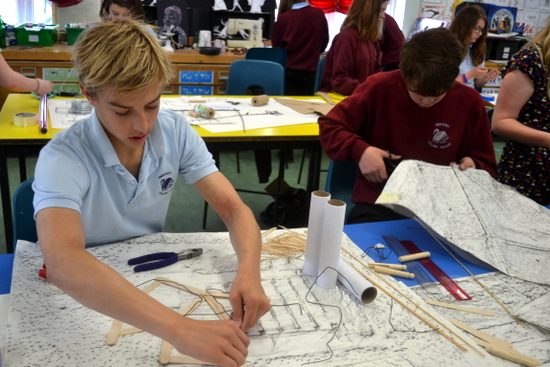 Boys experiment with mixed media responding to their drawings