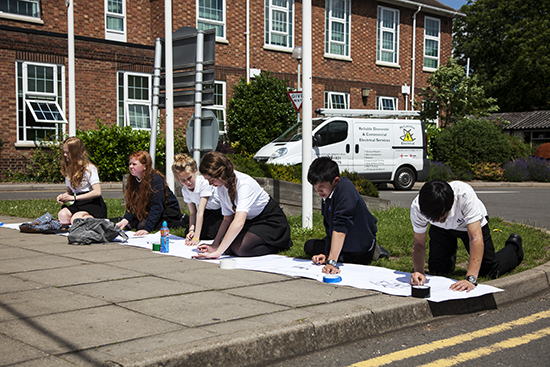Students at Chesterton Community College being led on drawing exercises by Anne to make them look and respond to the fabric of their school