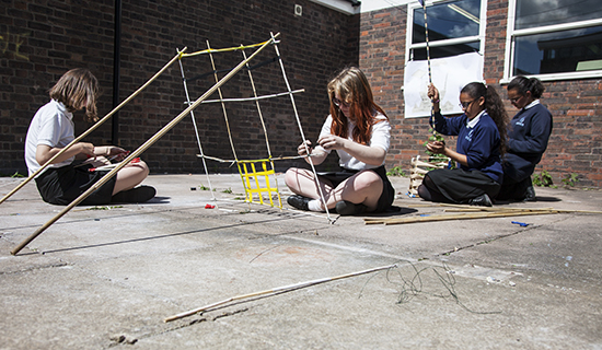 Group works on complex construction inspired by their drawings