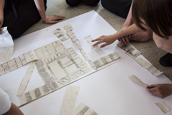 Students work collaging elements together to create a new building or image