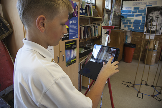 Student records the construction process on his iPad with a Stop Motion App