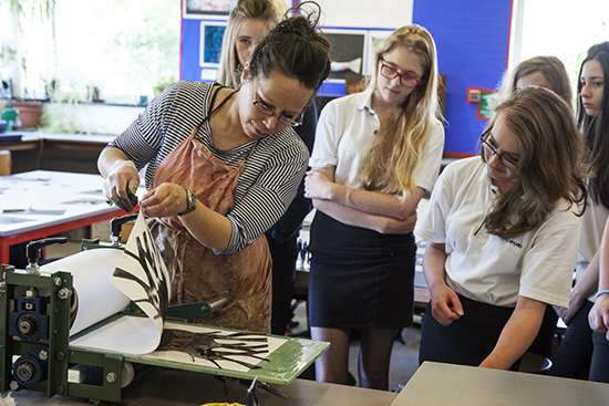 Hannah Webb works with students at Witchford Village College, Witchford