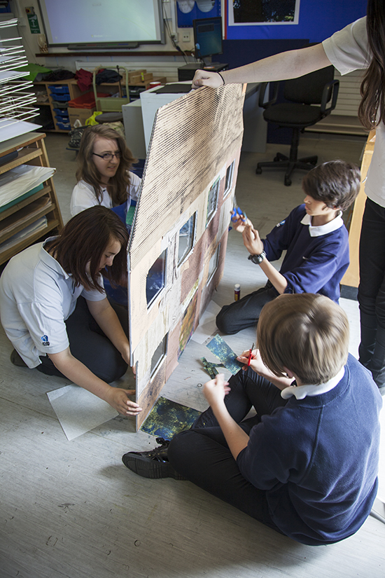 Students work, using prints, stuck on a pre-prepared panel to creating Witchford Hospital
