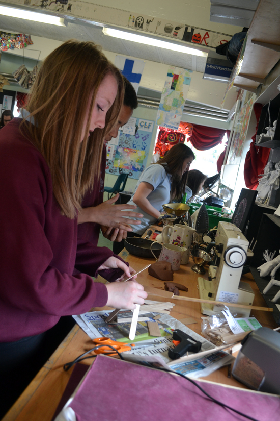 Student at Swavesey Village College constructs with sticks to find the limits of the material