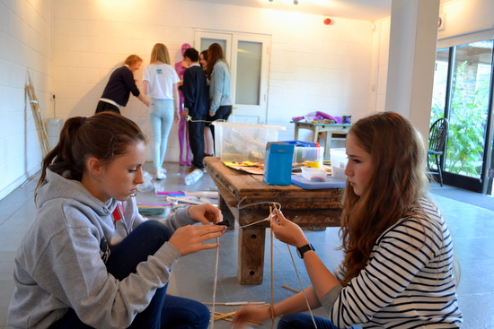 Mia and Anna get to work creating structures our of cane and wire