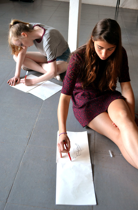 Jasmine and Ella sketching ideas for the Mitcham's Models on the first day of the project
