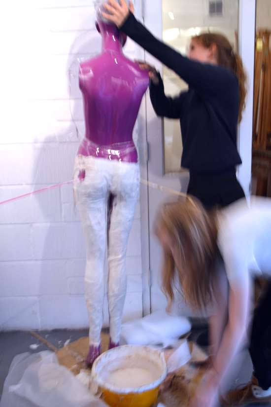 Students working in plaster and modroc to make skinny jeans
