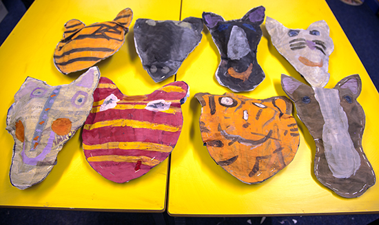 Textile and graphic artist Sharon Gale shows students in the Art Cabin at Northaw CE Primary School in Hertfordshire, how to make Newspaper Animal Heads.